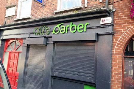 Ali's Barber raised letters