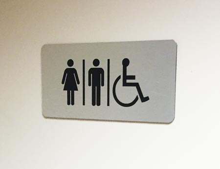 Brushed di-bond toilet directional sign
